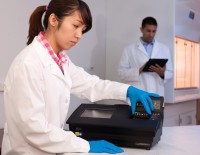 Lab technicians use the Hunter device during a test process. InstantLabs manufactures the Hunter system as well as test kits for food pathogens and species identification such as the catfish testing commercialization agreement outlined with the FDA.